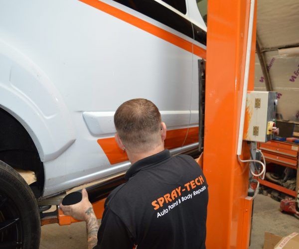 Staff Member Working On Van